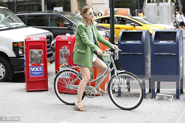 A fashionable girl riding a bike on Fifth Ave during New York fashion week
