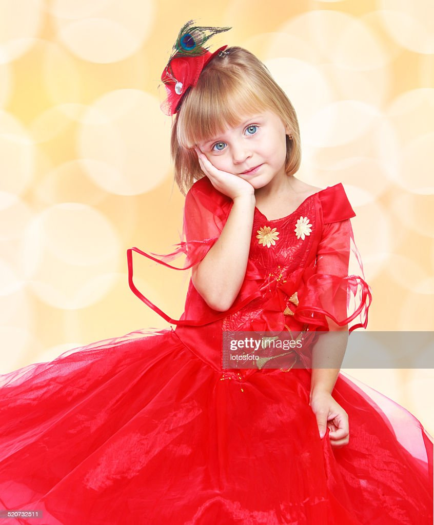 fashionable little girl in a bright red dress stock photo