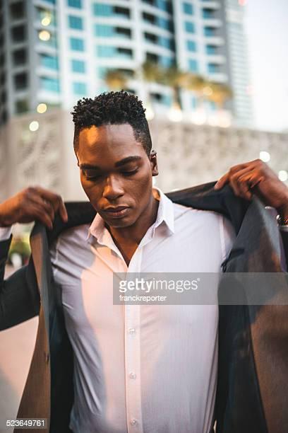 fashionable man posing on the city
