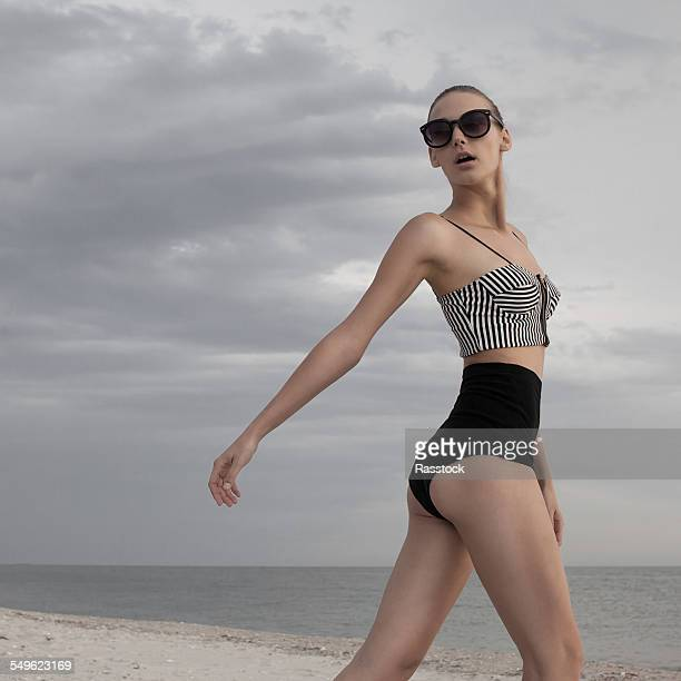 Fashionable model posing on stylish swimsuit
