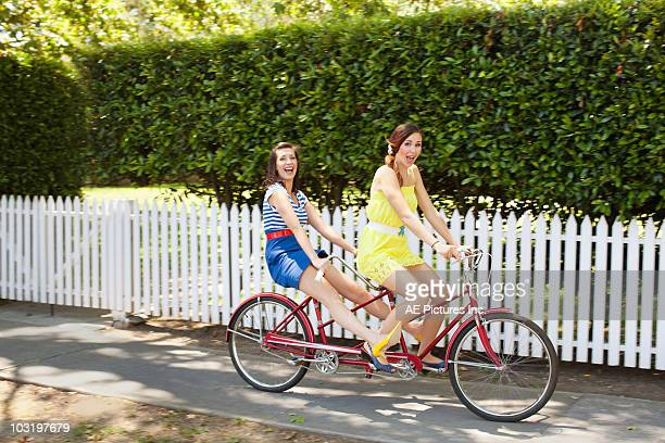 Fashionable pair ride tandem bike