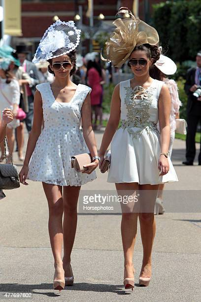Fashionable racegoers pose for photographers on Ladies Day at Royal Ascot Racecourse on June 18 2015 in Ascot England