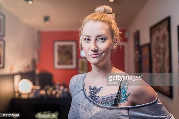Fashionable tattooed woman in studio