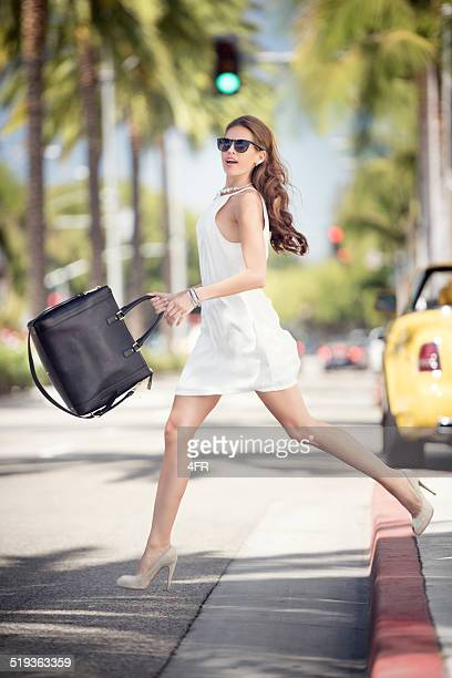 Fashionable Woman crossing the Street