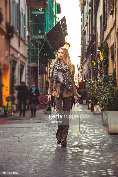 Fashionable woman shopping in central Rome