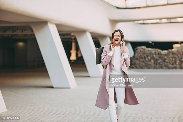 Fashionable woman talking on the phone