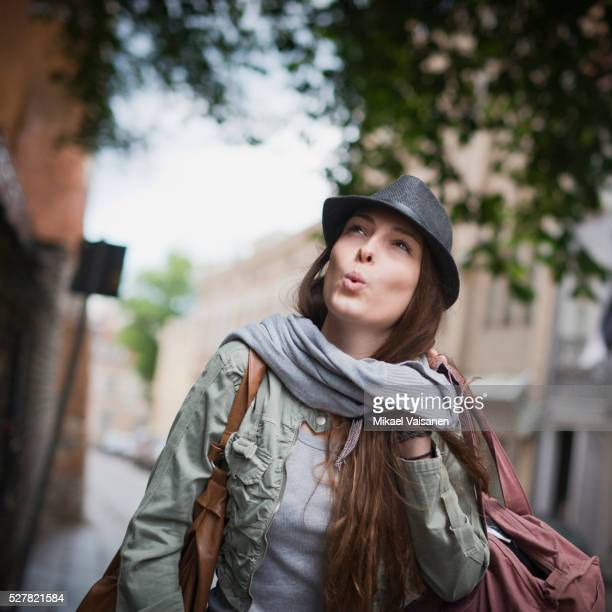 Fashionable woman whistling
