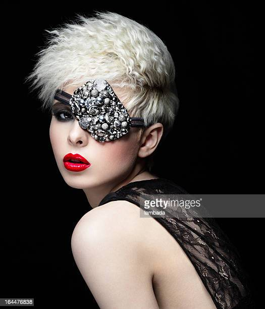 Fashionable woman with eye patch