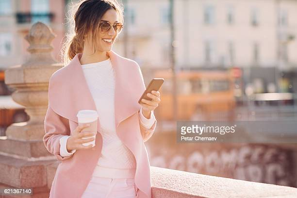 Fashionable woman with smart phone