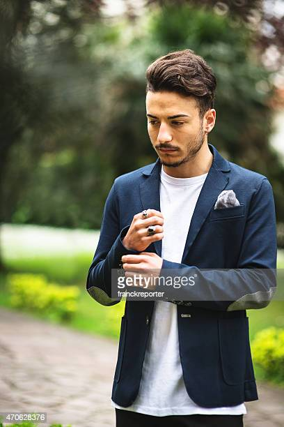 fashionable young adult posing serious