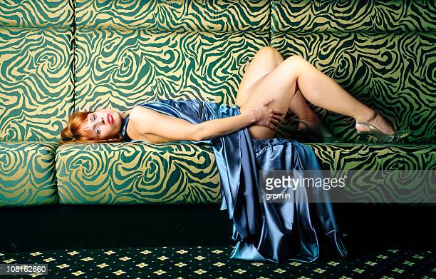 Fashionable Young Woman Laying on Floor