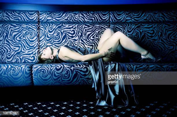 Fashionable Young Woman Laying on Sofa