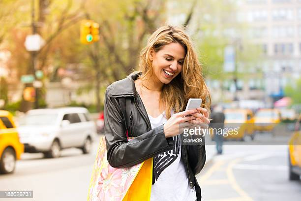 Fashionable Young Woman on a Cellphone in the City