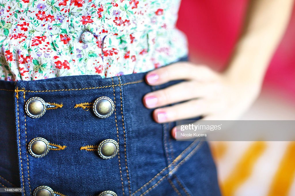 Fashionable young woman with buttonup shorts : Stock Photo