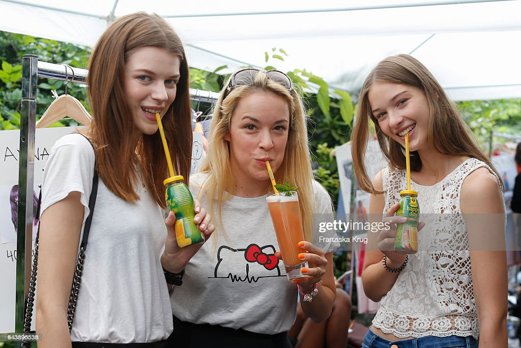 Fashiondesigner Marina Hoermanseder and models are drinking juice during the presentation of the Rauch Happy Day Limited Edition designed by Marina Hoermanseder ahead of the Marina Hoermanseder defilee during the Der Berliner Mode Salon Spring/Summer 2017 at Kronprinzenpalais on June 30, 2016 in Berlin, Germany.
