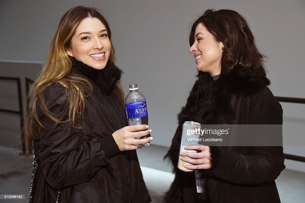 Fashiongoers drink Aquafina products during Fall 2016 New York Fashion Week on February 14, 2016 in New York City.