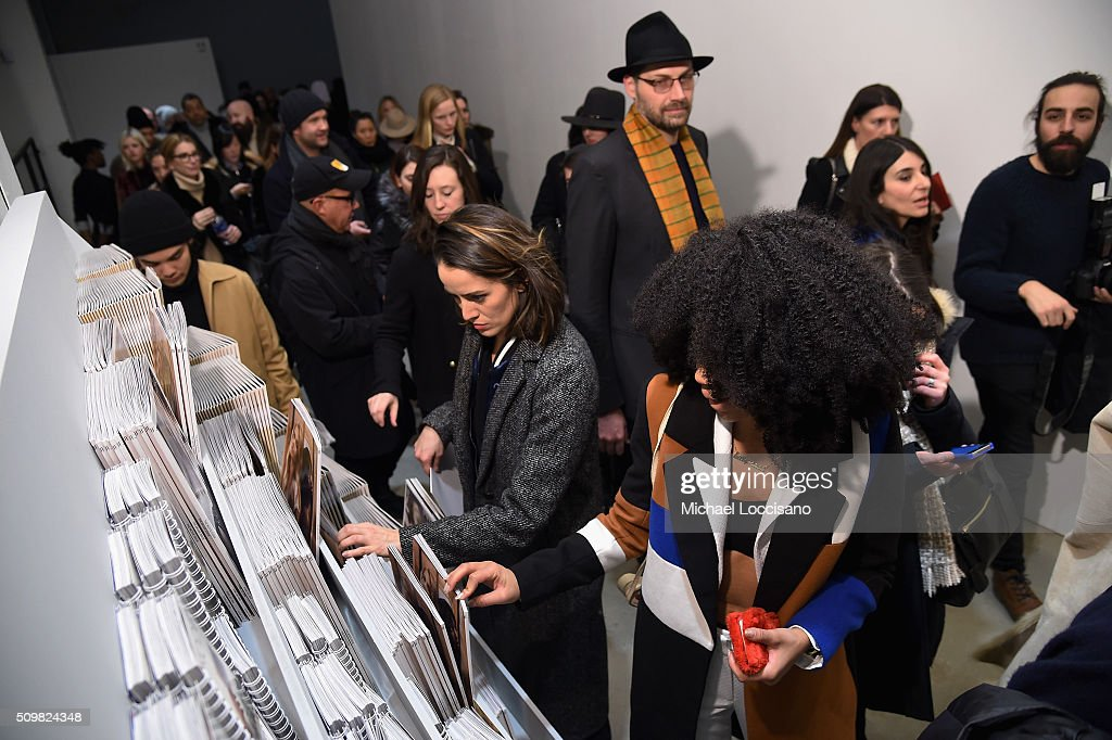 Fashiongoers have a look at the daily magazines during New York Fashion Week: The Shows at Clarkson Sq on February 12, 2016 in New York City.