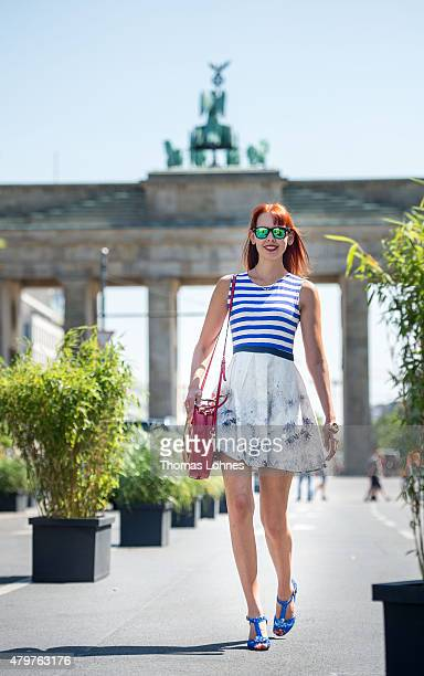 Fashionjournalist Sussan Zeck wearing shoes from 'George Love' dress from 'Eggs' and a purse from 'Vintage' during the MercedesBenz Fashion Week...