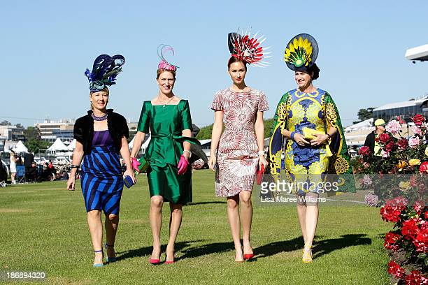 Fashions on the Field contestants pose during Melbourne Cup Day at Flemington Racecourse on November 5 2013 in Melbourne Australia