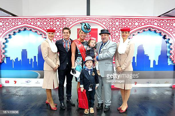 Fashions on the Field judge Johnny Ruffo and Fashions on Field Family winners The Worrells from Macrae pose on Stakes Day at Flemington Racecourse on...