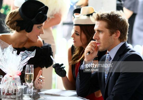 Fashions on the Field judges Laura Dundovic Rebecca Judd and Hugh Sheridan converse during the AAMI Golden Slipper Day at Rosehill Gardens Racecourse...