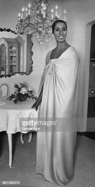 Fashions Women Couture designer Bobbie Jean Williams wears her creation of mauve matte jersey a full length cape knots gently drapes over a slim gown...