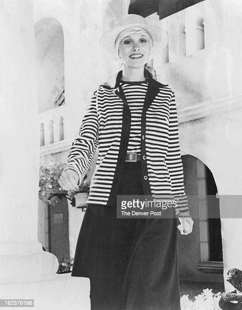 MAR 6 1977 MAR 31 1977 Fashions Women Joan Curtis' easyfitting dress of Monsanto polyester coordinates with cardigan Credit The Sunday Denver Post