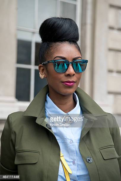 Fashon blogger Marsha Campbell wears Topshop jacket and shirt Chanel broach Kite sunglasses and an LK Bennett bag on February 21 2015 in London...