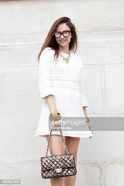 Fashon Editor and Visual Artist Patricia Contrevas wearing a Chanel bag necklace and dress Hermes bracelet and Spektre sunglasses day 3 of Paris...