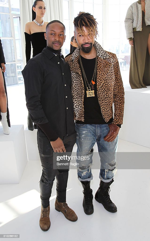 Fasihon designer LaQuan Smith (L) and stylist Ty Hunter pose during SheaMoisture at Laquan Smith F/W 2016 NYFW at Jack Studios on February 14, 2016 in New York City.