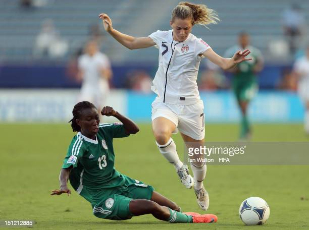 Fasilat Adeyemo of Nigeria competes for the ball with Kealia Ohai of the USA during the FIFA U20 Women's World Cup SemiFinal match between Nigeria...