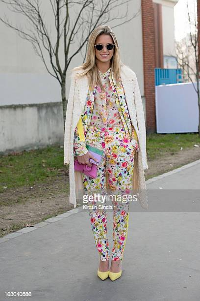 Fasion blogger Helena Bordon wears a Chanel jacket MSGM shirt and trousers Celine shoes Charlotte Olympia bag and Oliver Peoples sunglasses on day 4...