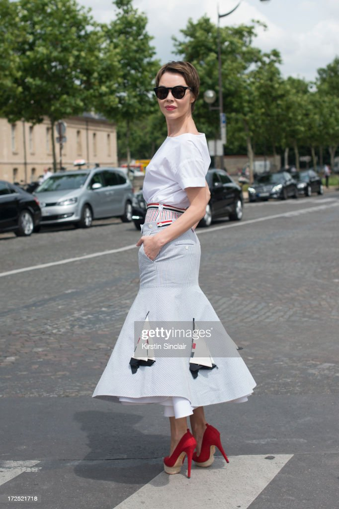 Fasion designer and photographer Ulyana Sergeenko wears a Thom Browne top and skirt with Charlotte Olympia shoes on day 1 of Paris Collections: Womens Haute Couture on July 01, 2013 in Paris, France.
