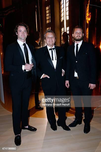 Fasion Designer JeanCharles de Castelbajac standing between his sons LouisMarie de Castelbajac and his brother Guilhem de Castelbajac enjoy a Martell...