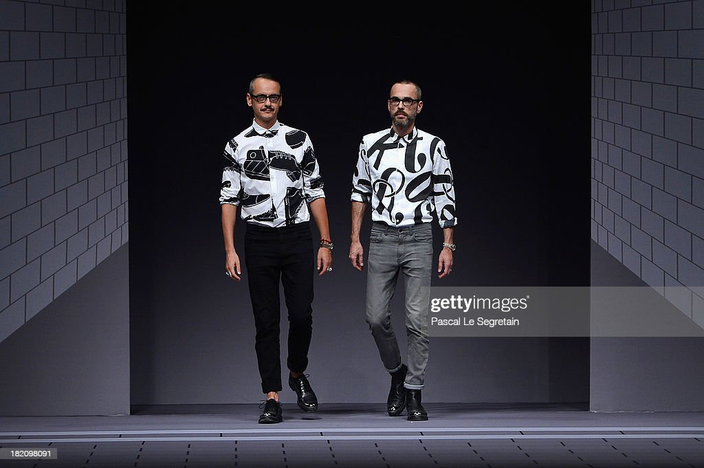 Fasion designers Viktor Horsting and Rolf Snoeren walk the runway during Viktor & Rolf show as part of the Paris Fashion Week Womenswear Spring/Summer 2014 at Espace Ephemere Tuileries on September 28, 2013 in Paris, France.