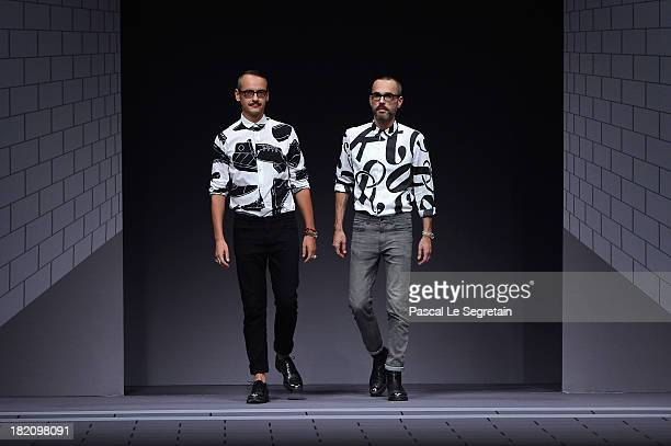 Fasion designers Viktor Horsting and Rolf Snoeren walk the runway during Viktor Rolf show as part of the Paris Fashion Week Womenswear Spring/Summer...