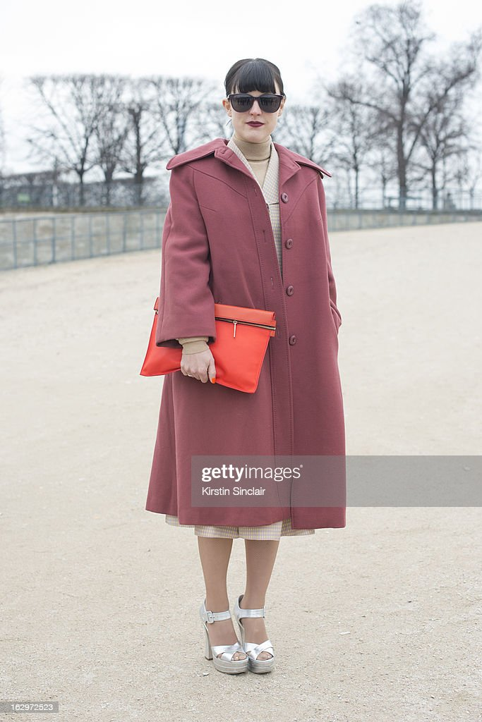 Fasion editor at Garage magazine Chloe Kerman wears Miu Miu shoes, Prism sunglasses, Victoria Beckham bag and a vintage jacket on day 2 of Paris Womens Fashion Week Autumn/Winter 2013 on March 1, 2013 in Paris, France.