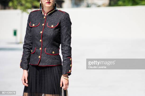 Fasion stylist and blogger Angelina Lepper wears Compagnia Italiana black and red jacket Oroblu black skirt and Roberto di Stefano golden bag on June...