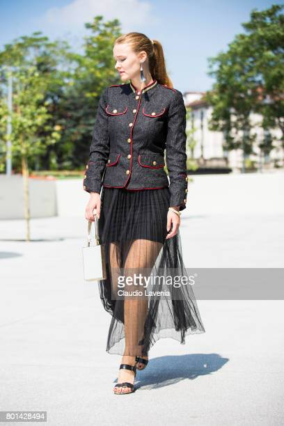 Fasion stylist and blogger Angelina Lepper wears Compagnia Italiana black and red jacket Oroblu black skirt Asos shoes and Roberto di Stefano golden...
