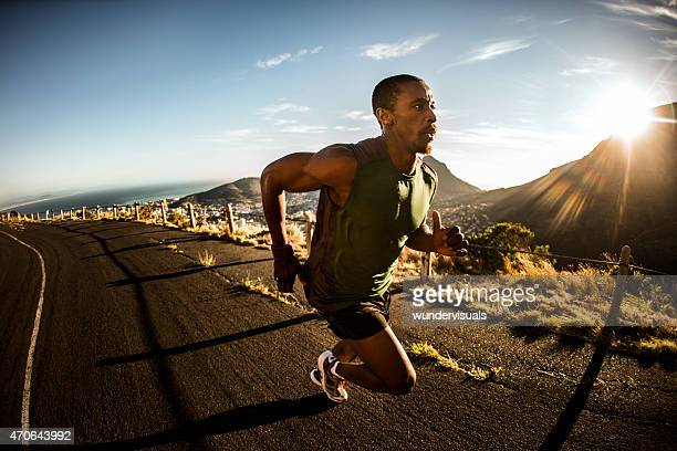 Fast African American athlete sprinting during fitness training
