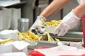 fast food restaurant French fries being prepared by a cook