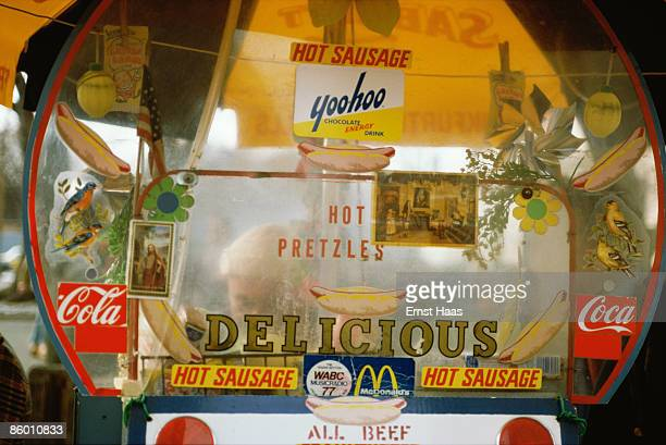 A fast food stand advertising hot dogs and CocaCola March 1975