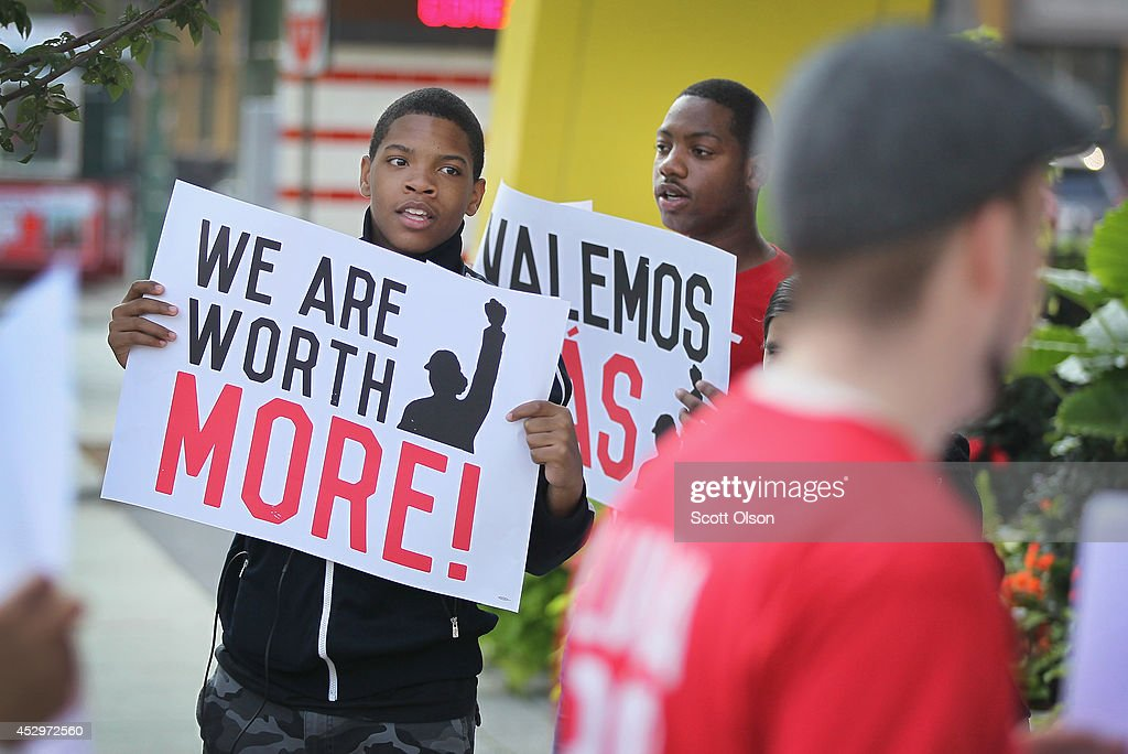 Fast food workers and activists demonstrate outside McDonald's downtown flagship restaurant on July 31 2014 in Chicago Illinois According to a recent...