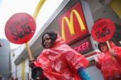 Fast food workers and activists demonstrate outside McDonald's downtown flagship restaurant on May 15 2014 in Chicago Illinois The demonstration was...