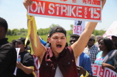 Fast food workers and activists demonstrate outside the McDonald's corporate campus on May 21 2014 in Oak Brook Illinois The demonstrators were...