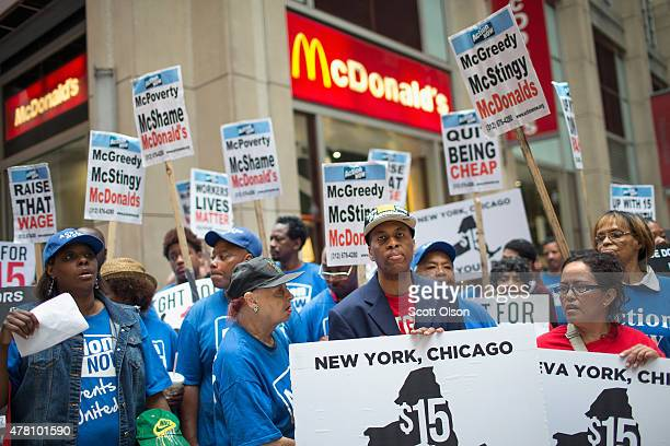 Fast food workers and community activists protest outside a McDonald's restaurant in the Loop on June 22 2015 in Chicago Illinois The protestors were...