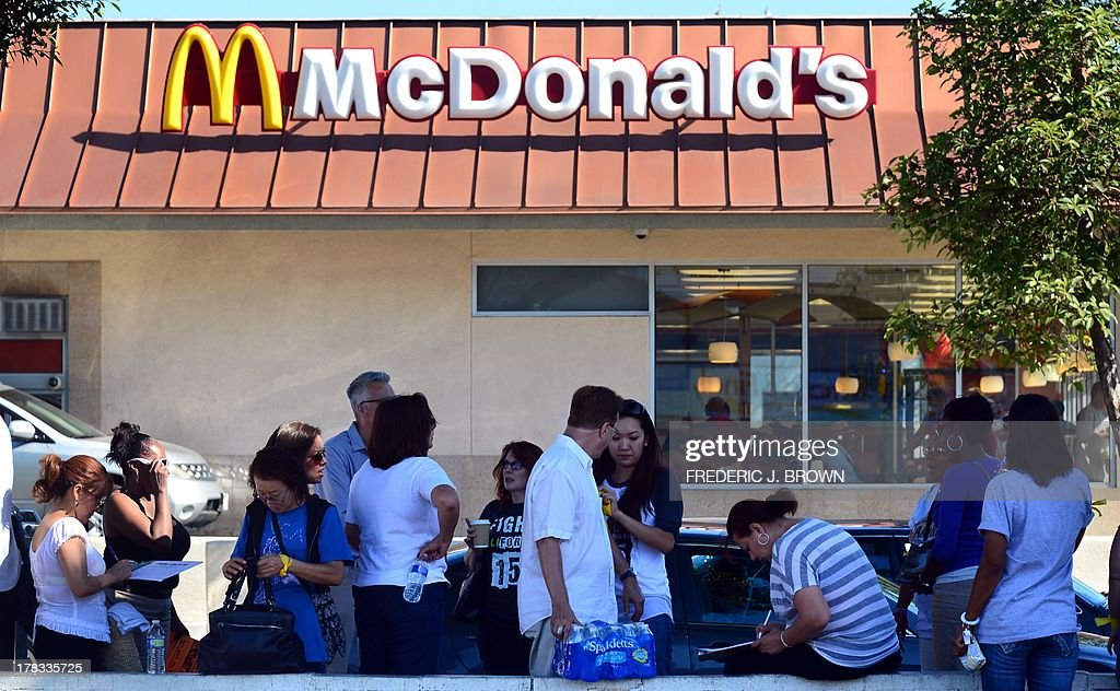 Fast food workers and their supporters gather for a nationwide strike outside a McDonald's fastfood outlet demanding higher wages and the right to form a union on August 29, 2013 in Los Angeles, California, where the fast food restaurant workers were calling for a $15.00 per hour wage. AFP PHOTO/Frederic J. BROWN