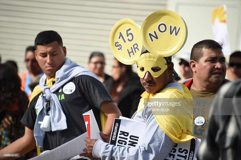 Fast food workers, healthcare workers and their supporters shout slogans at a rally and march to demand an increase of the minimum wage to 15USD per hour, in Los Angeles on December 4, 2014. The nationwide protest is expected to reach 190 US cities.