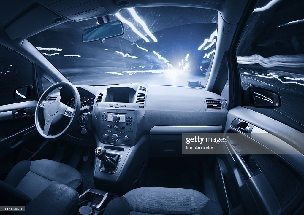Fast ghost car into the light traffic. : Stock Photo