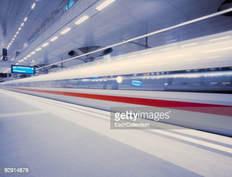 A fast ICE train leaving Berlin Central Station : Stock Photo